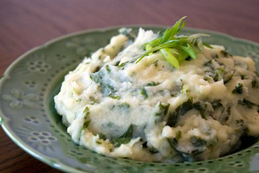 Colcannon - Traditional Irish mashed potatoes with kale or cabbage and green onions. Simple, Sinful. To die for.