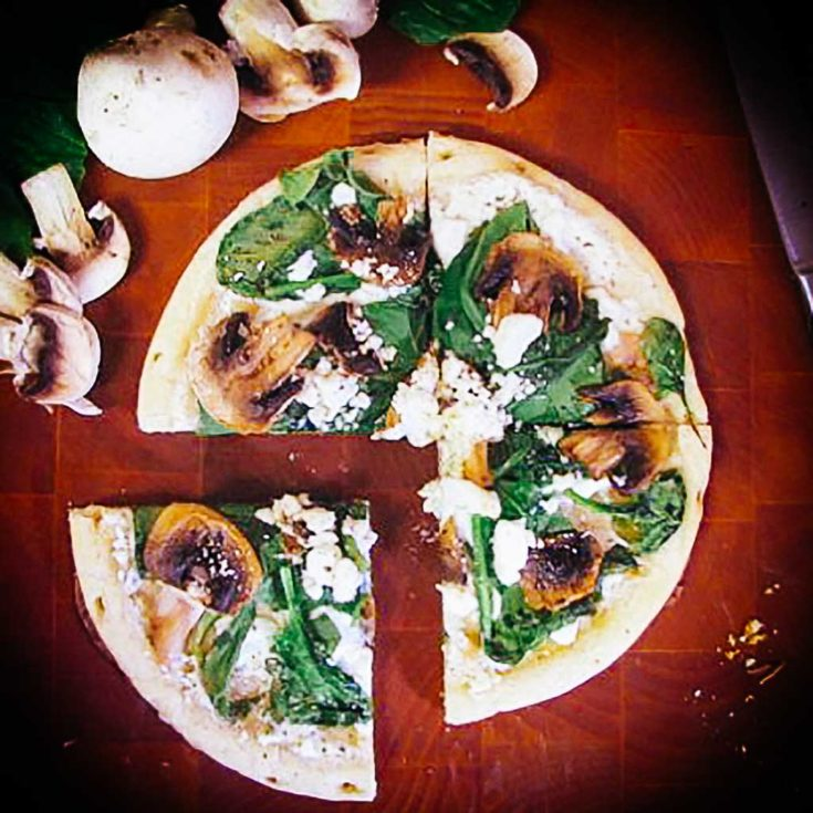 Spinach, mushroom and goat cheese pizza