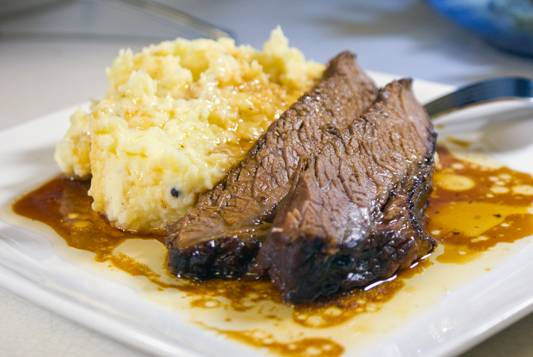 Oven smoked brisket with mashed potatoes and drippings. Yum!
