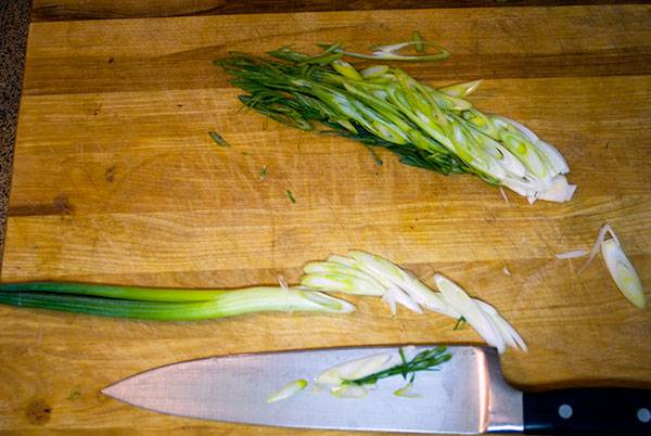 Slice the green onions diagonally