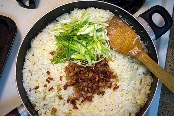 Add the bacon and green onions to the bacon fried rice.