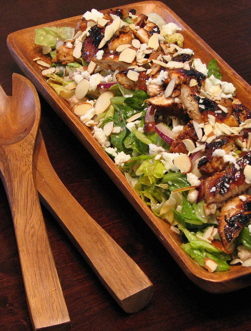 Chicken and field green salad with feta, almonds and raspberry vinaigrette