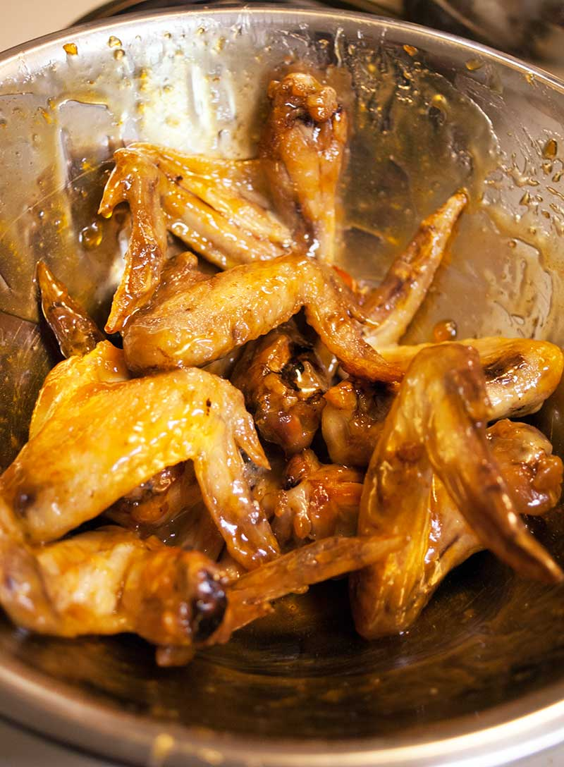 Toss wings in sesame-apricot sauce