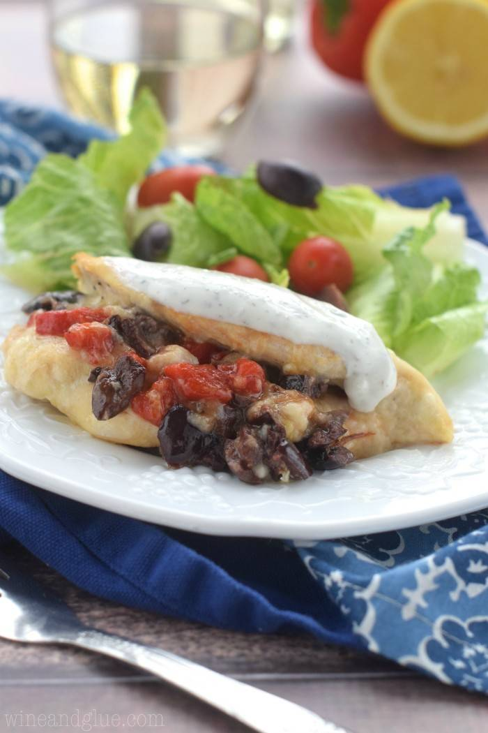 This Greek Stuffed Chicken is a fancy dinner that comes together easily! It is jam packed with flavor!