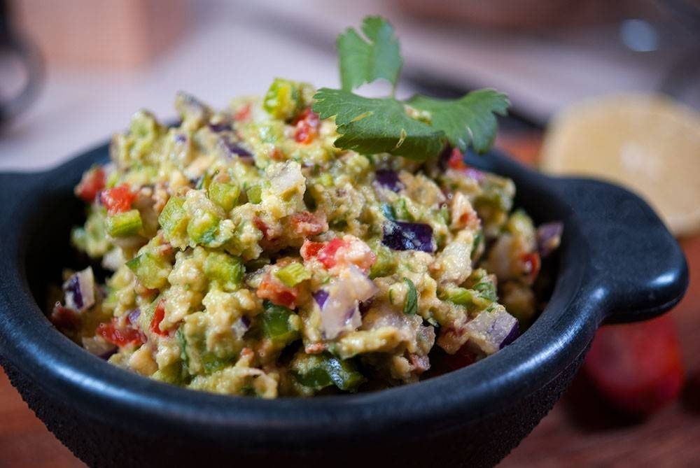 Chunky Guacamole with red onions and bacon. A lovely rustic take on a classic with a smoky crunch.