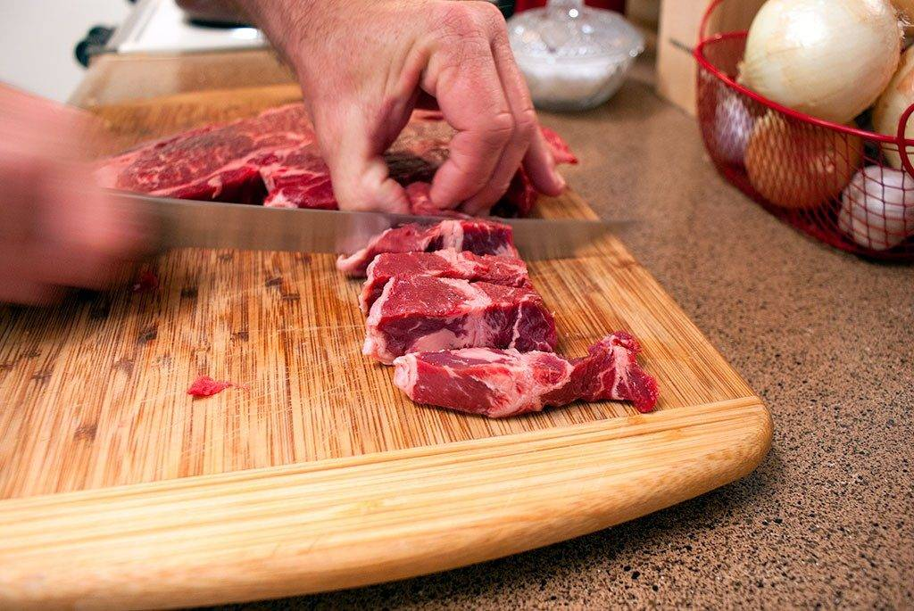 Cut beef into bite-sized pieces step one