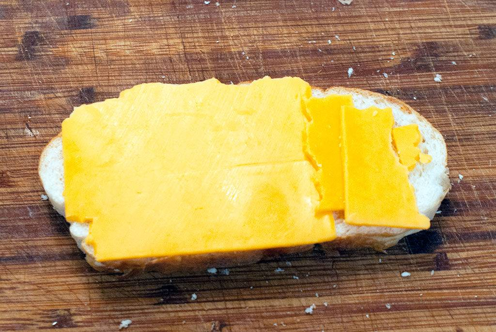 Assembling the Roast Beef Melt Sandwich. First, lay out some cheese