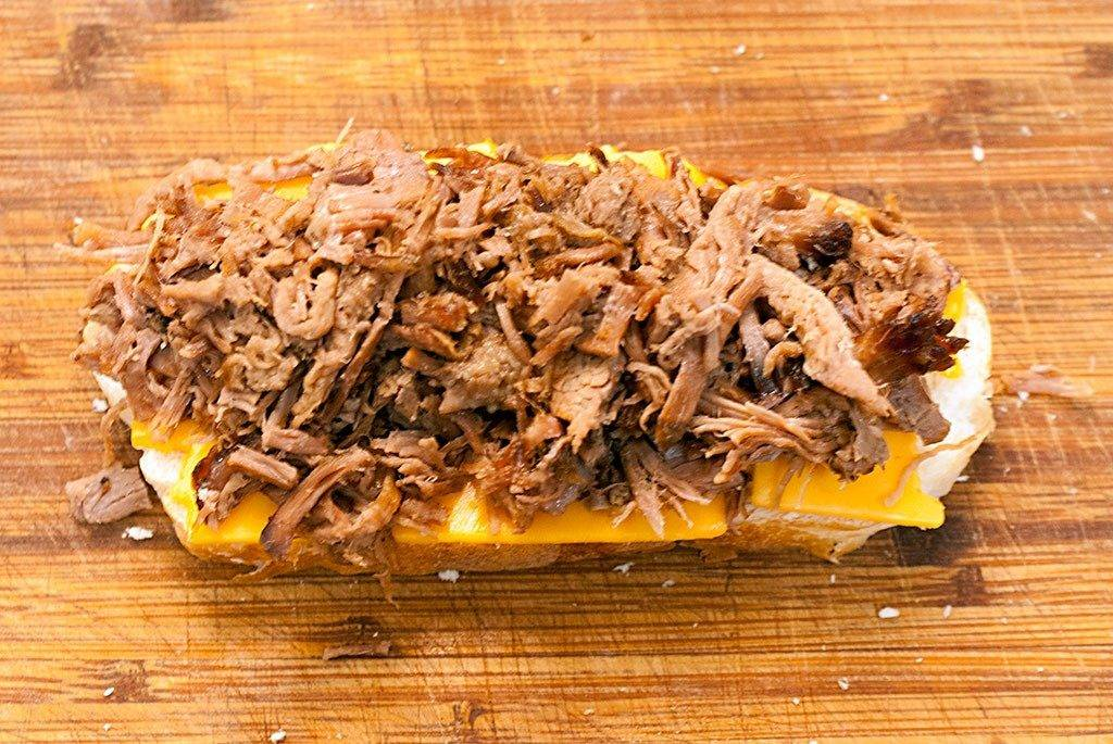 Assembling the Roast Beef Melt Sandwich. Next, lay out some of that gorgeous beef.