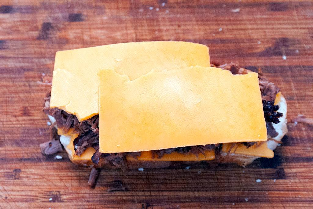 Assembling the Roast Beef Melt Sandwich. Lay on more 100% real, natural cheese.