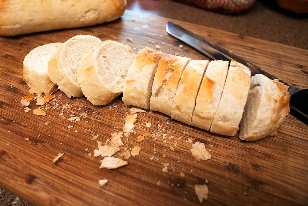 Slice rounds of a crusty Baguette to make croutons for poached whitefish in white wine sauce.