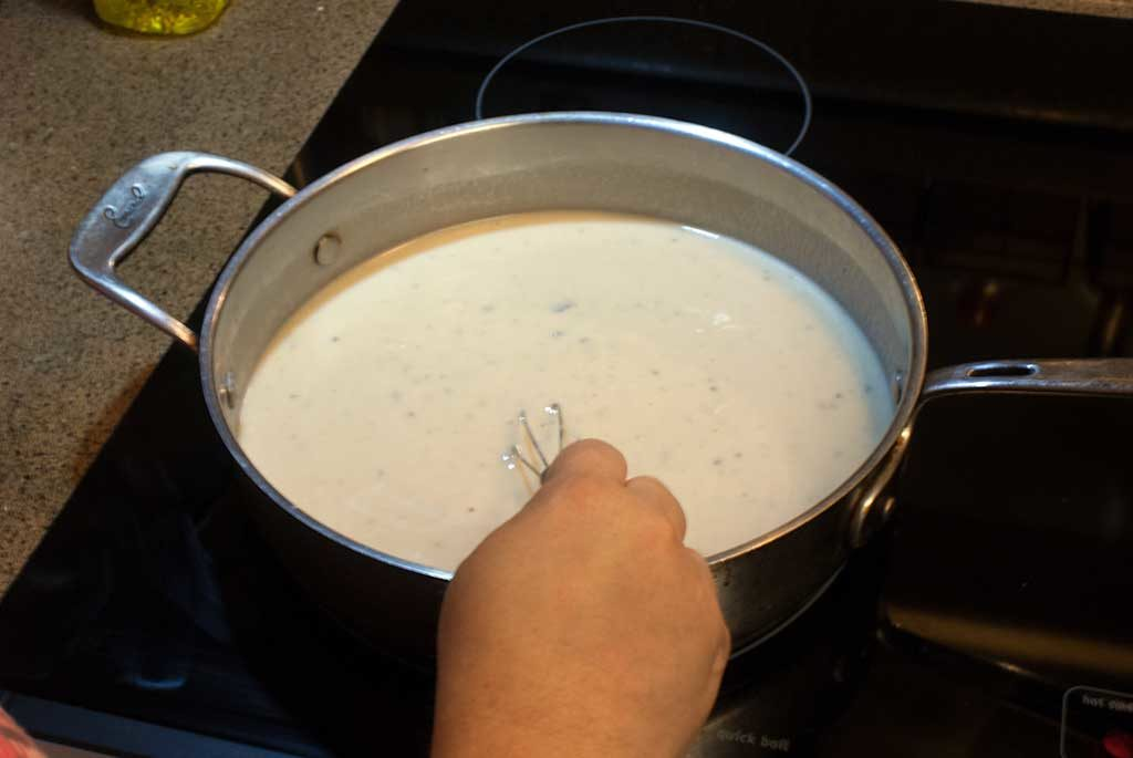 Mix condensed soup and milk until smooth