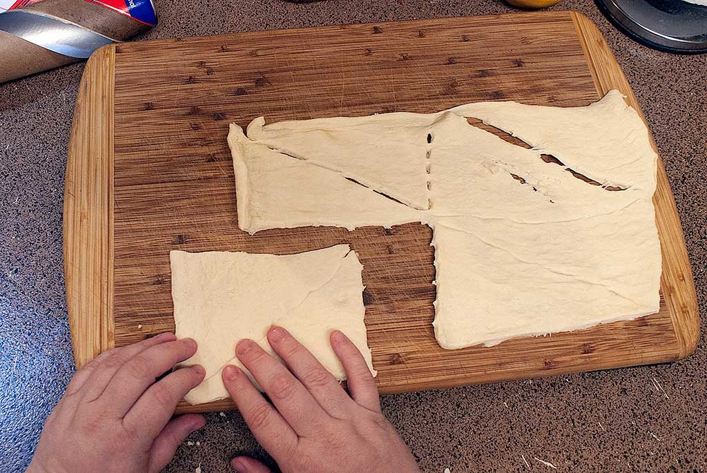 Forming crescent roll dough into rectangles