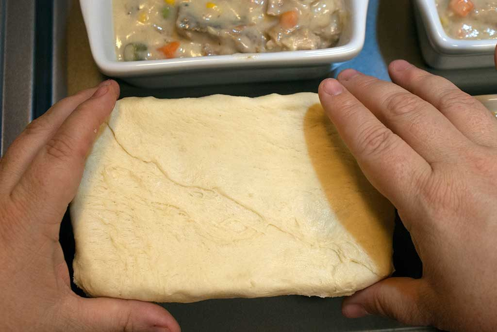 Covering baking dish with shaped crescent dough