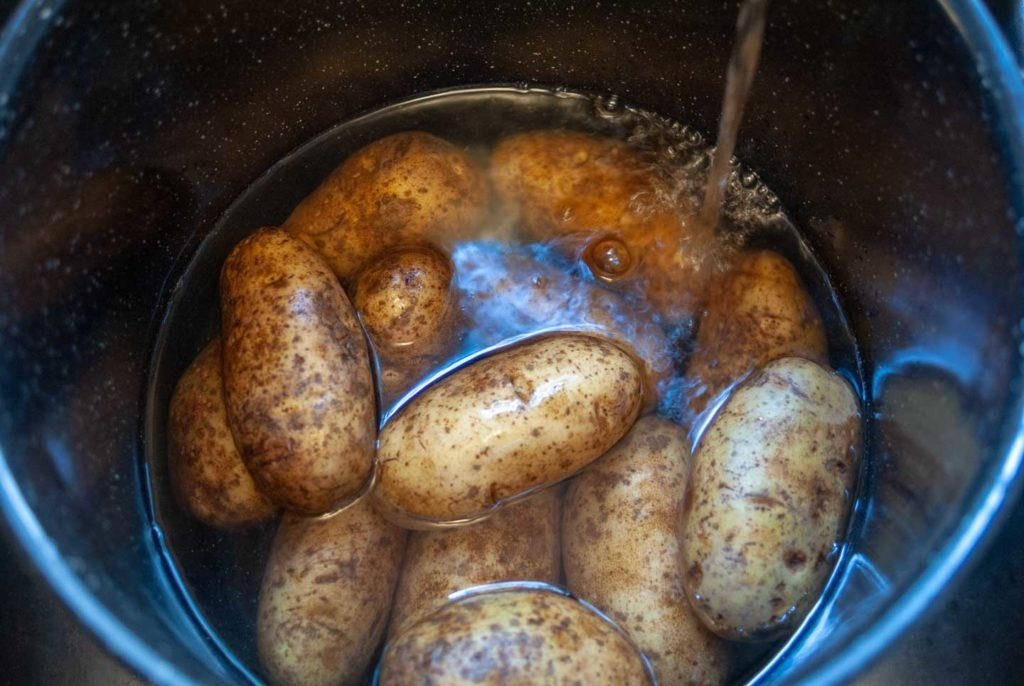 Cover potatoes with water in a large pot