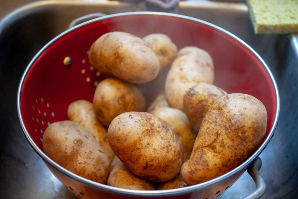 Cooked potatoes in strainer