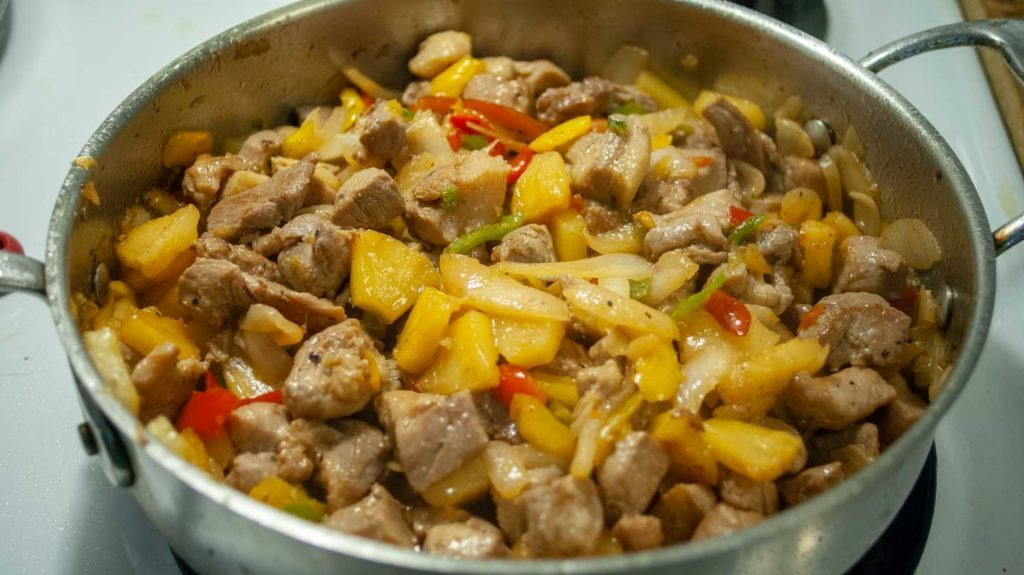 Pork and pineapple in a skillet