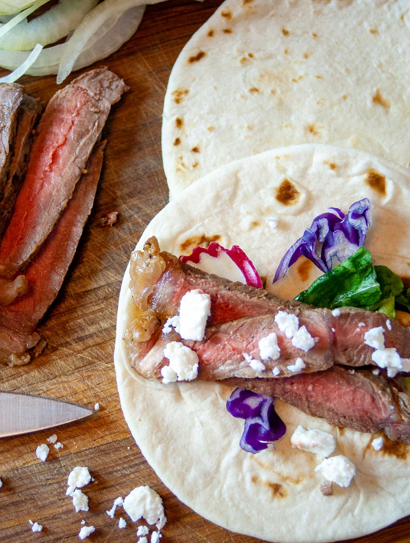 Steak and Feta tacos are perfect for a quick weeknight meal or for a weekend BBQ meal hot off the grill!