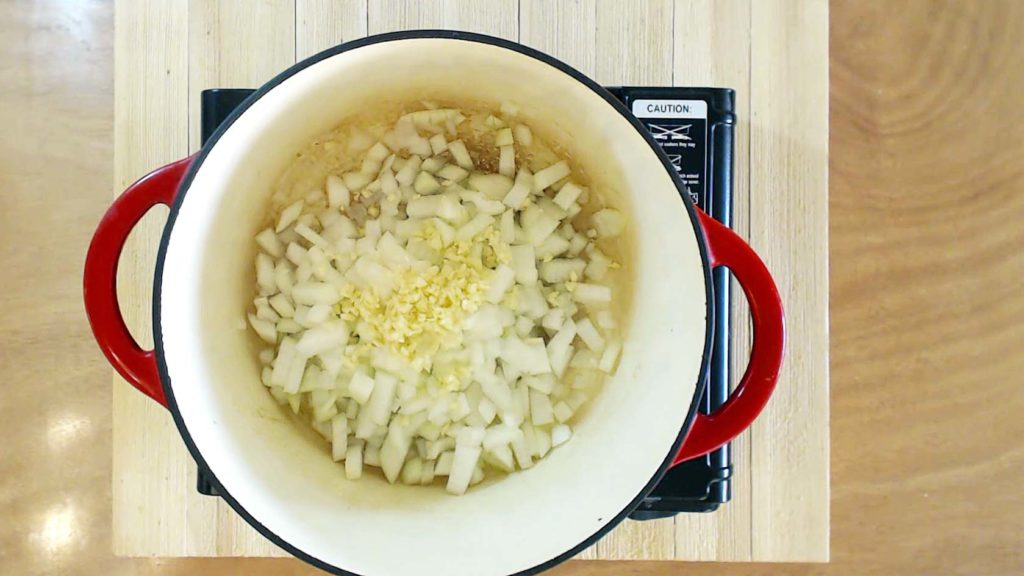 Onions and garlic in a dutch oven