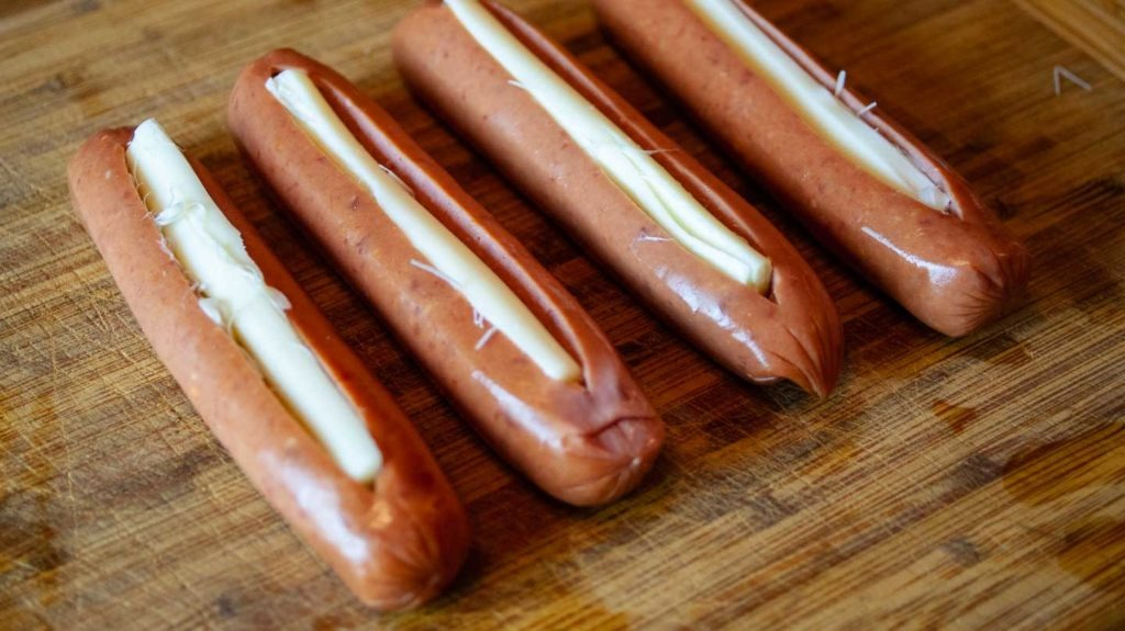 Uncooked sausages stuffed with string cheese
