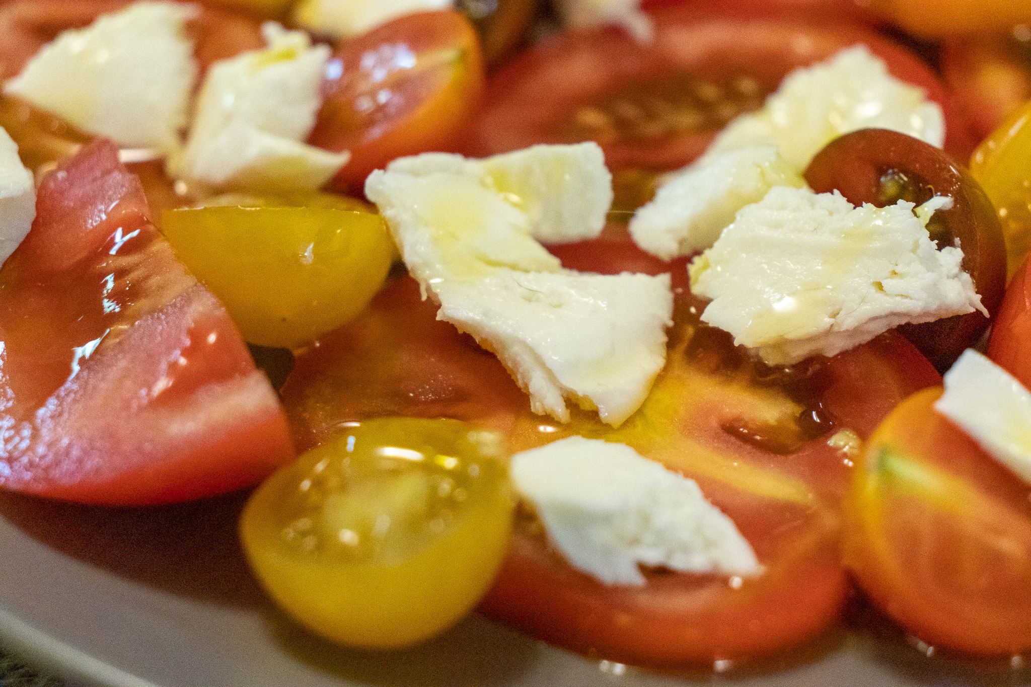 Tomatoes, Mozzarella cheese, and olive oil