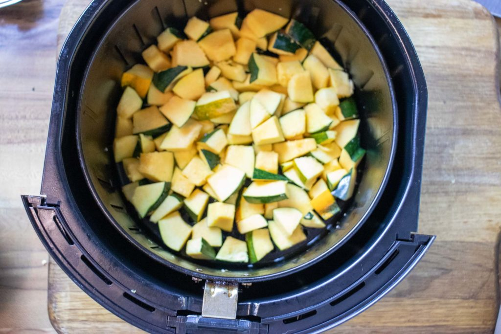 Cubed squash in air fryer basket