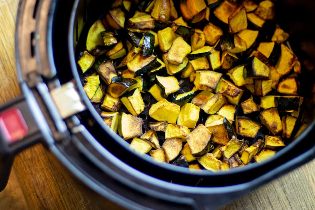 Roasted acorn squash in air fryer basket