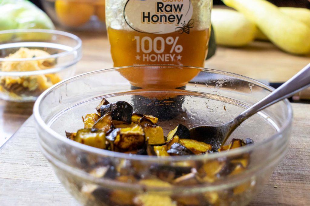Coating roasted acorn squash in raw honey