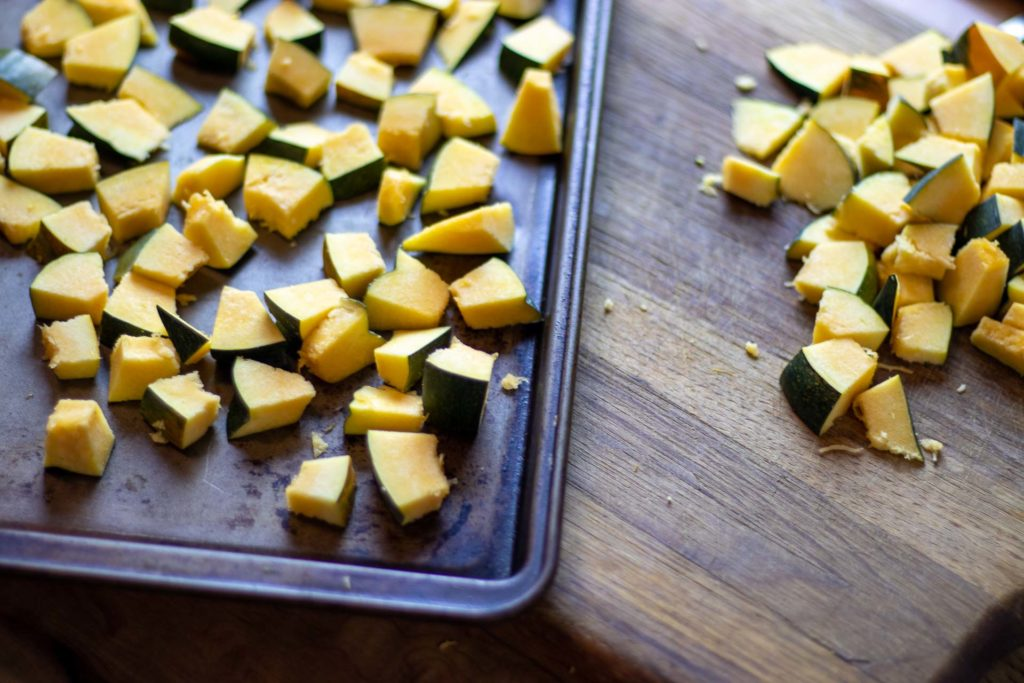 Cubed squash on a baking sheet