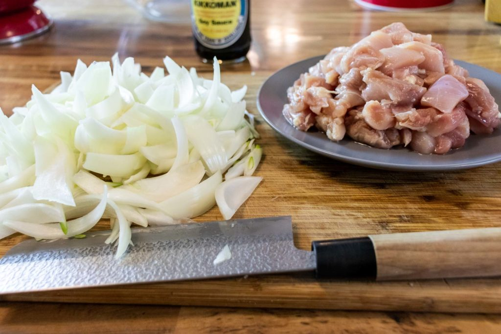 Diced onions and chopped raw chicken