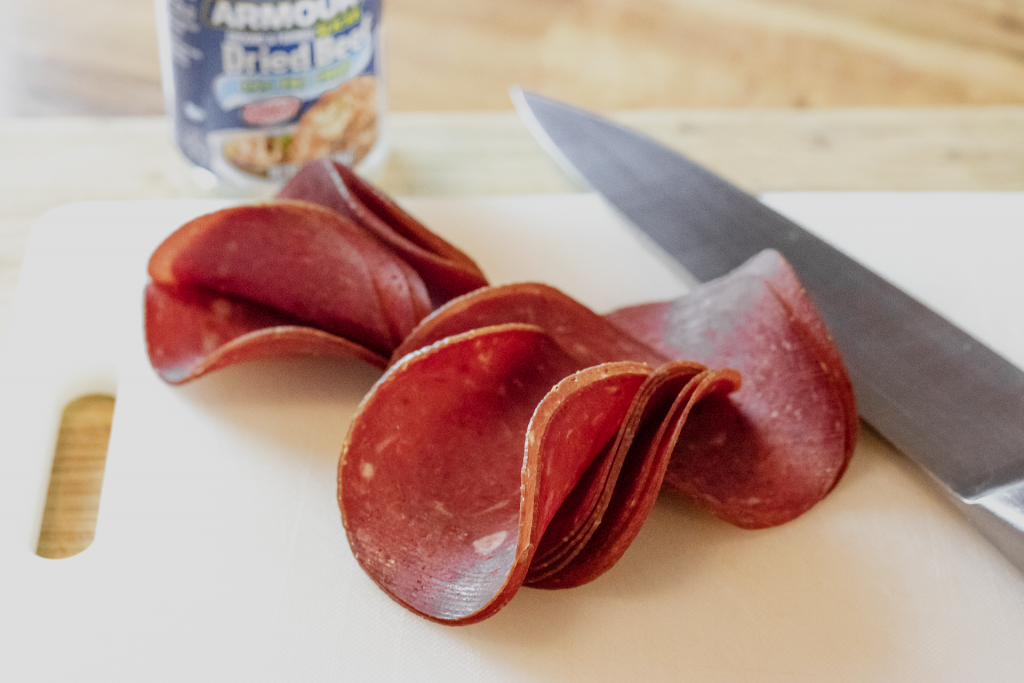 """Dried """"chipped"""" beef on a cutting board."""